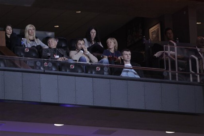 New Jersey Nets owner Mikhail Prokhorov, right, watches the first quarter of an NBA basketball game between the Philadelphia 76ers and the New Jersey Nets, Tuesday, April 10, 2012, in Newark, N.J. (AP Photo/Julio Cortez)
