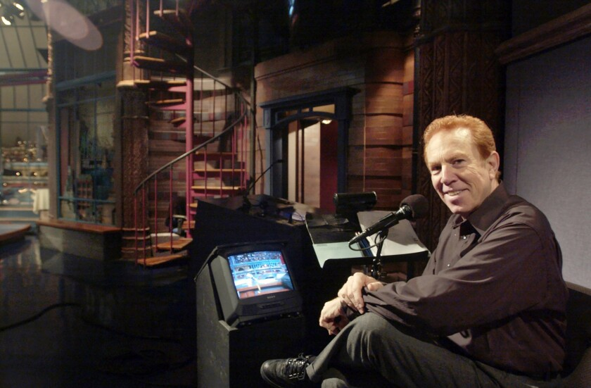"""FILE - In this Nov. 20, 2003, file photo, """"Late Show With David Letterman'' announcer Alan Kalter poses in the the Late Show studio in New York. Kalter, the quirky, red-headed announcer for David Letterman for two decades who frequently appeared in the show's comedy bits, has died Monday, Oct. 4, 2021, at Stamford Hospital in Connecticut. He was 78. (Andrew Sullivan/Hearst Connecticut Media via AP, File)"""