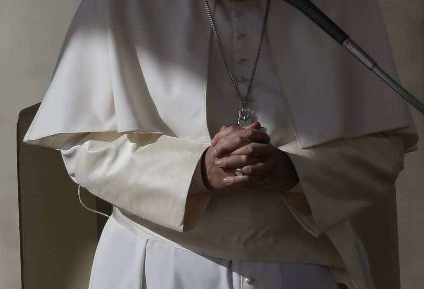 Pope Francis prays at the end of his weekly general audience in St. Peter's Square at the Vatican, Wednesday, Nov. 4, 2015. (AP Photo/Alessandra Tarantino)