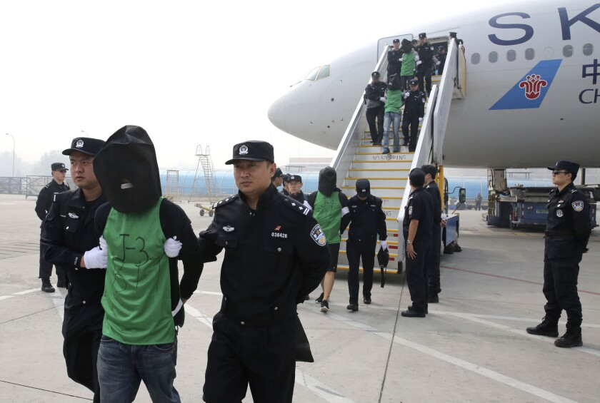 Chinese and Taiwanese citizens who were deported from Kenya arrive at Beijing Capital International Airport on April 13, 2016. The move focuses new attention on Beijing's willingness to assert its sovereignty claim over the Taiwan, and the leverage it wields over smaller nations in backing that position.