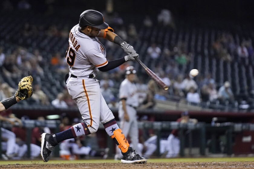San Francisco Giants' Thairo Estrada connects for a grand slam against the Arizona Diamondbacks during the ninth inning of a baseball game Friday, July 2, 2021, in Phoenix. The Giants won 11-4. (AP Photo/Ross D. Franklin)