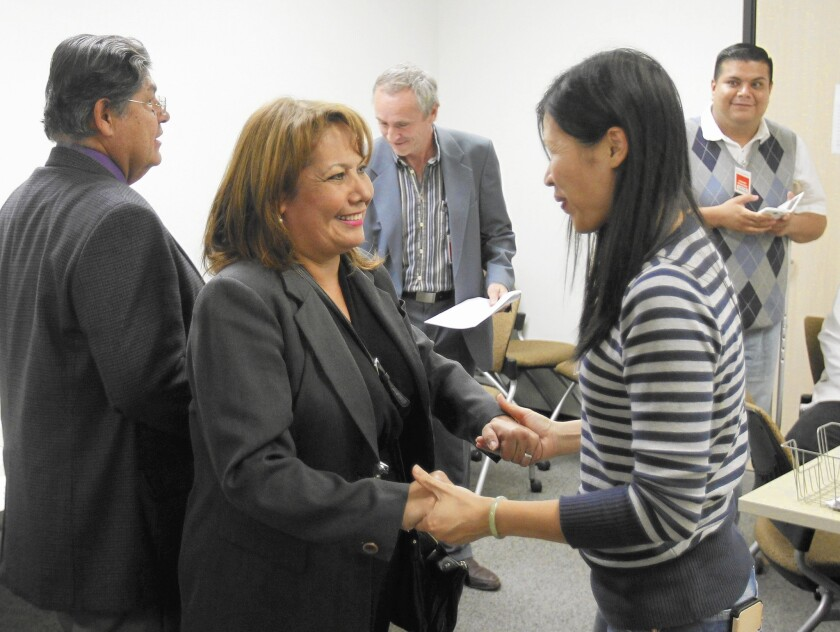 Chunyan Zhu, right, congratulates Patty Lopez as she is notified that she is ahead in the vote count last week in the race with Assemblyman Raul Bocanegra.
