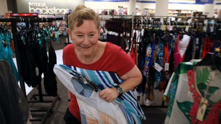 "Sharon Zite, of Skokie, shops at Macy's Backstage in Old Orchard Shopping Center in Skokie on July 26, 2018. ""It seems nice, and it's an interesting store. It is like a store within a store,"" she said."