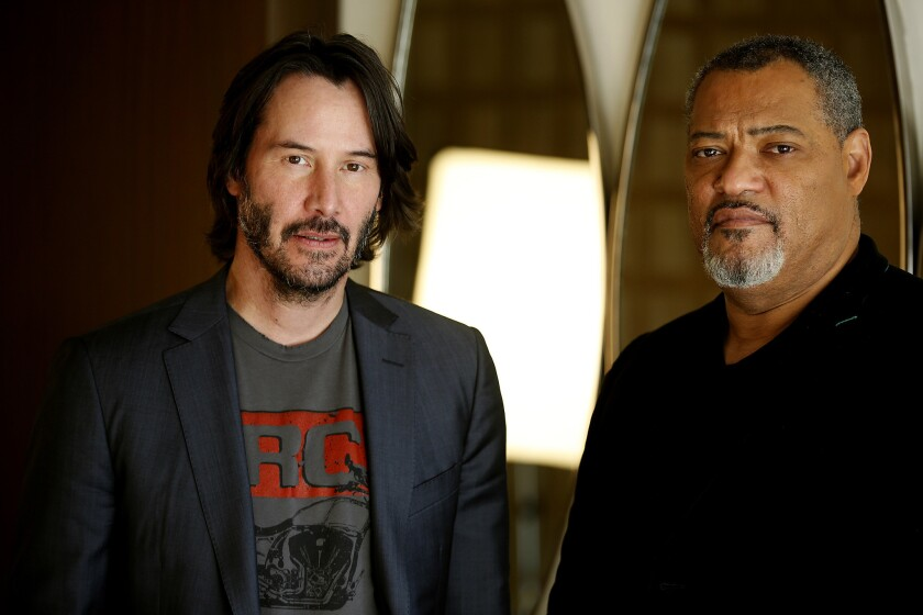"Laurence Fishburne (right) with his ""Matrix"" co-star Keanu Reeves."