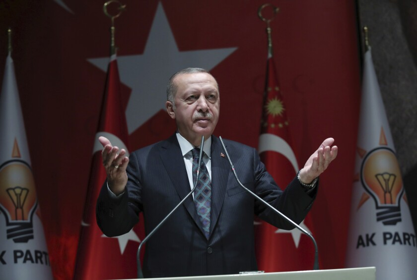 "Turkey's President Recep Tayyip Erdogan speaks to his ruling party officials, in Ankara, Turkey, Thursday, Oct. 10, 2019. Erdogan says that there have been 109 ""terrorists killed"" — a reference to Syrian Kurdish fighters — since Ankara launched an offensive into Syria the previous day. Erdogan also warned the European Union not to call Ankara's incursion into Syria an 'invasion,' and renewed his threat of letting Syrian refugees flood Europe. (Turkish Presidency Press Service via AP, Pool)"