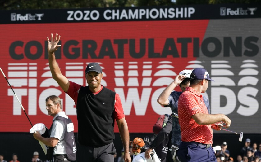 Tiger Woods celebrates after winning the Zozo Championship.