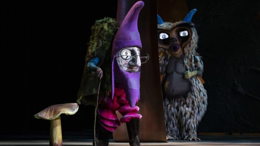 LOS ANGELES, CA - NOVEMBER 15, 2018: A purple gnome and an owl during a scene in LA Opera's Hansel