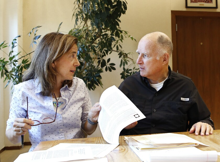 Gov. Jerry Brown reviews a measure with his wife, Anne Gust Brown, at his Capitol office, Sunday, Sept. 30, 2018, in Sacramento, Calif.