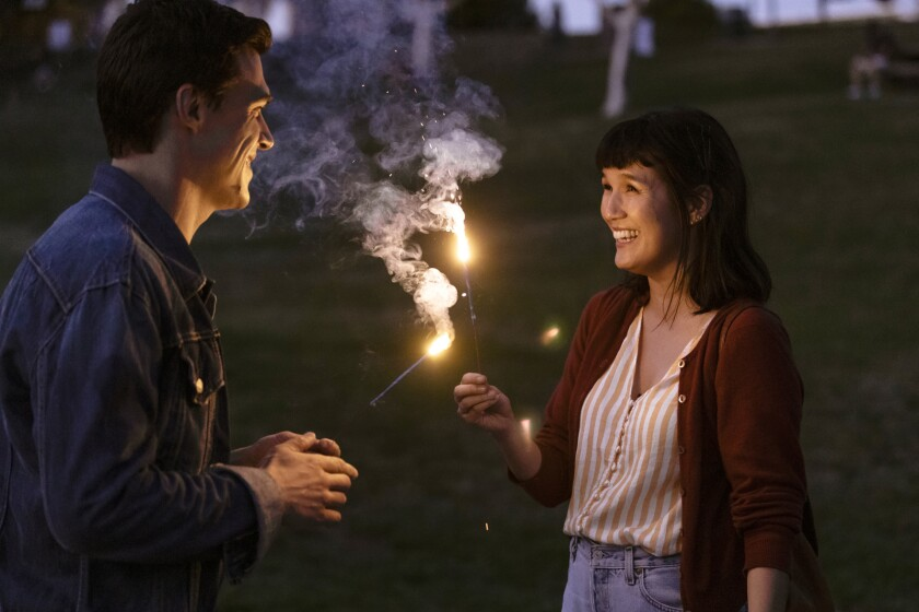 """Finn Wittrock and Zoe Chao hold sparklers in the movie """"Long Weekend."""""""