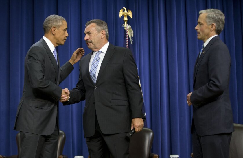 President Obama shakes hands with Los Angeles Police Chief Charlie Beck during a forum on criminal justice reform last week in Washington. At right is John Walsh, U.S. attorney for the District of Colorado.