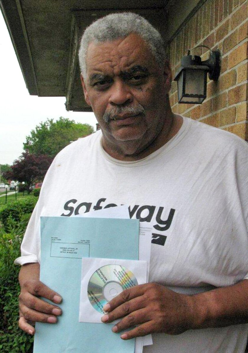 In this May 27, 2014 photo retired Detroit bus driver Art Vardiman holds a computer disk he received in the mail that holds hundreds of pages of documents, a six-page blue ballot about cuts to his pension and a white one on health insurance in Detroit. Retirees with pensions at risk have until July 11 to vote on Detroit's exit plan from bankruptcy. General retirees like Vardiman would see a 4.5 percent cut in their pension and elimination of annual inflation payments. Police and fire retirees fare better. (AP Photo/Ed White)