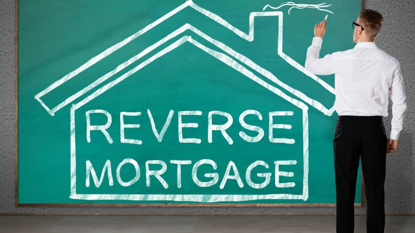 Businessman Drawing House With Reverse Mortgage Text