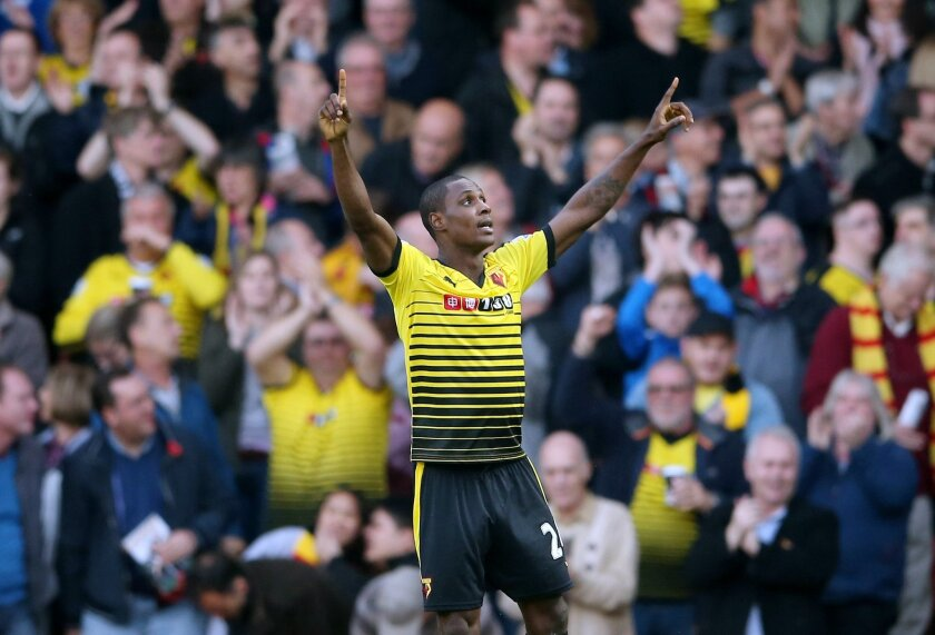Watford's Odion Ighalo celebrates after scoring their second goal of the game during their English Premier League soccer match against West Ham at Vicarage Road, London, Saturday, Oct. 31, 2015. (Scott Heavey/PA via AP)     UNITED KINGDOM OUT      -    NO SALES     -    NO ARCHIVES
