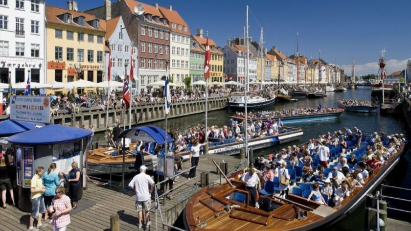 Tour boats in Copenhagen, Denmark, which was selected as Lonely Planet's top city to visit in 2019.