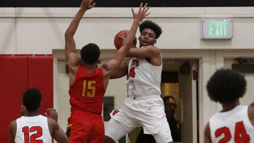 Westchester's Kaelen Allen looks to pass after driving the baseline against Fairfax on Friday.