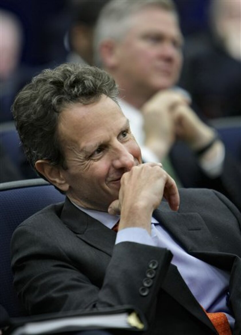 Treasury Secretary Timothy Geithner listens at the opening of President Barack Obama's jobs summit, officially known as the Jobs and Economic Growth Forum, Thursday, Dec. 2009, in the Eisenhower Executive Office Building on the White House campus in Washington. (AP Photo/J. Scott Applewhite)