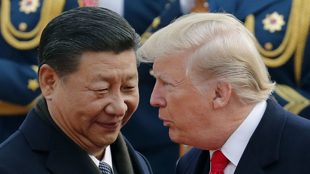 Chinese President Xi Jinping and President Trump chat during a welcome ceremony in Beijing in 2017.