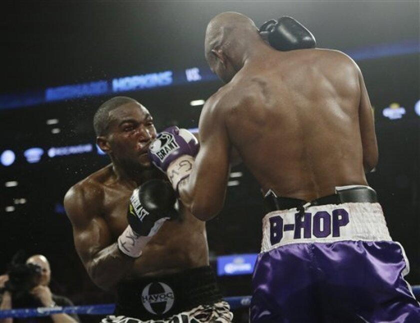 Bernard Hopkins, right, punches Tavoris Cloud during the 12th round of an IBF Light Heavyweight championship boxing match at the Barclays Center Saturday, March 9, 2013, in New York. Hopkins won by unanimous decision. (AP Photo/Frank Franklin II)