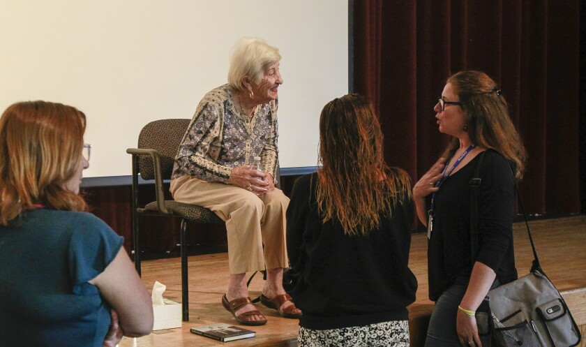 Rose Schindler (2nd from left) speaks to audience members at Ramona High School after her presentation on Wednesday, October 23, 2019.