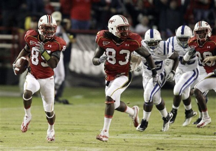 Maryland's Tony Logan (85) returns a punt against Duke for a touchdown as teammate Emani Lee-Odai (83) runs along during the second half of an NCAA college football game, Saturday, Oct. 2, 2010, in College Park, Md. (AP Photo/Rob Carr)