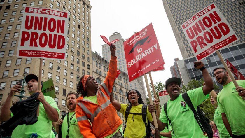 Union activists and supporters rally in June in New York City.