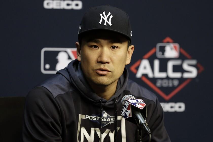 Yankees right-hander Masahiro Tanaka addresses the media at a news conference Oct. 11, 2019.