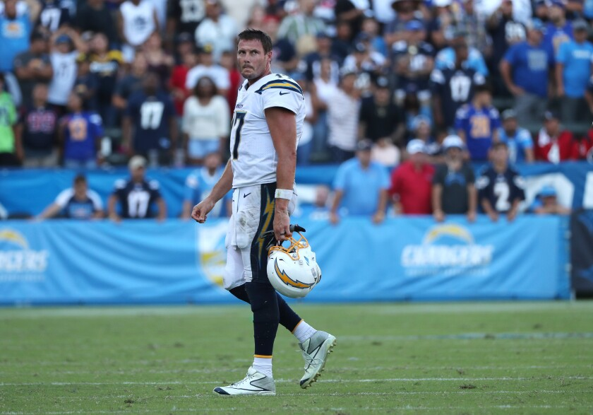 Chargers quarterback Philip Rivers walks off the field in the final moments of the Chargers' 27-20 loss to the Houston Texans on Sunday.