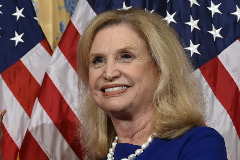 """FILE - In this Jan. 3, 2019 file photo, Rep. Carolyn Maloney, D-N.Y., is sworn-in during the opening session of the 116th Congress, on Capitol Hill in Washington. Three years after the opening of the Smithsonian's landmark Museum of African American History and Culture, momentum is building toward the creation of a museum dedicated to American women's history. The House of Representatives on Tuesday passed a bill to establish the museum inside the Smithsonian network and take steps toward funding and construction. The vote was 374-37. """"Seeing role models doing things we all aspire to can change the course of someone's life,"""" said Rep. Carolyn Maloney, D-N.Y., one of the bill's principal sponsors. (AP Photo/Susan Walsh)"""