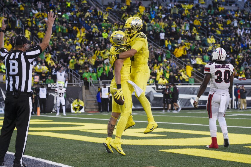 Oregon tight end Terrance Ferguson (19), left, celebrates his touchdown with Oregon tight end Moliki Matavao (8) during the third quarter of an NCAA college football game against Stony Brook Saturday, Sept. 18, 2021, in Eugene, Ore. (AP Photo/Andy Nelson)