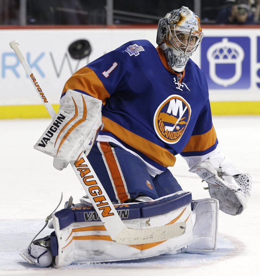 New York Islanders goalie Thomas Greiss makes a save during the third period of an NHL hockey game against the Detroit Red Wings, Monday, Feb. 15, 2016, in New York. The Islanders defeated the Red Wings 4-1. (AP Photo/Seth Wenig)