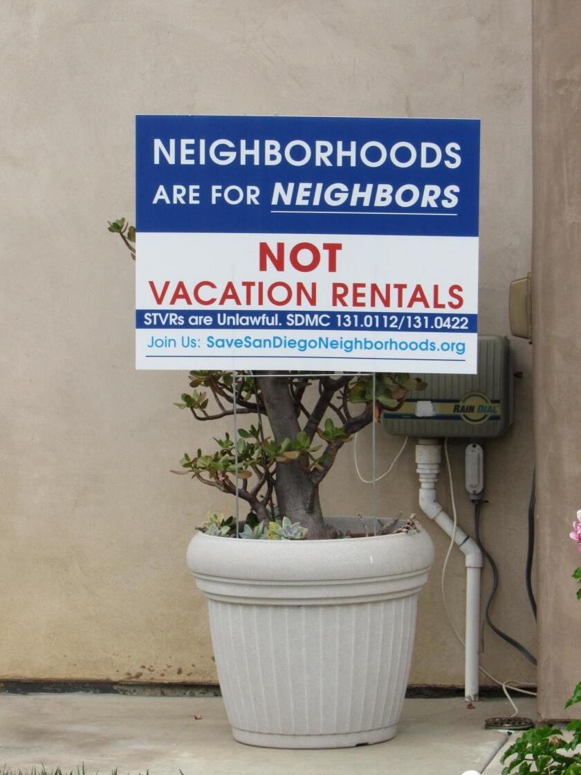 Signs like this one have popped up in across La Jolla and Pacific Beach for the past two years as residents opposed to short-term rentals in their neighborhoods banned together in protest.
