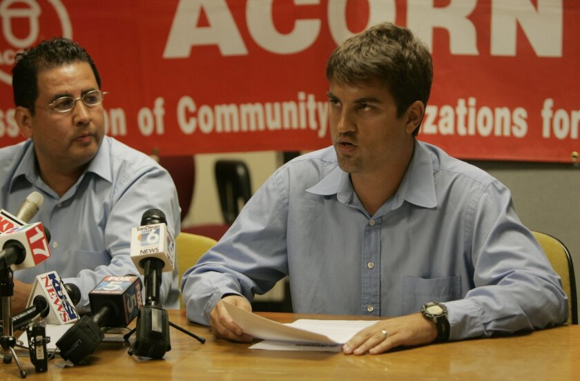 David Lagstein (right), director of the ACORN office in National City, spoke at a news conference yesterday alongside community organizer Juan Carlos Vera. (Peggy Peattie / Union-Tribune)