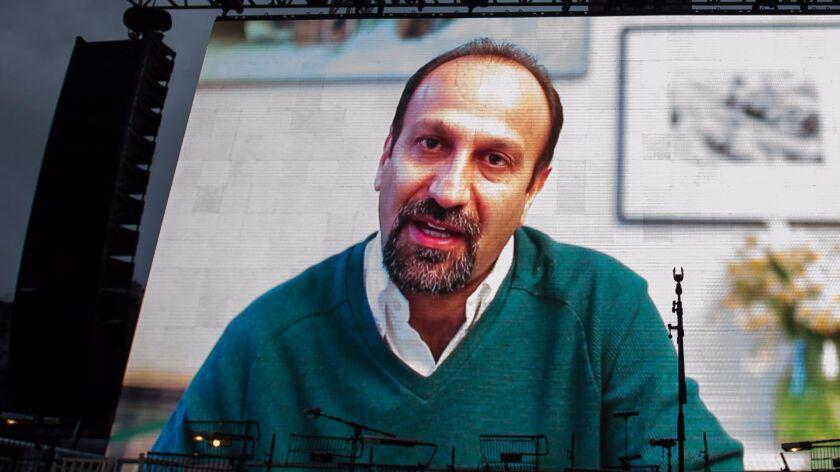 "Iranian filmmaker Asghar Farhadi speaks in a recorded video message during the public screening for his film ""The Salesman"" in London's Trafalgar Square."