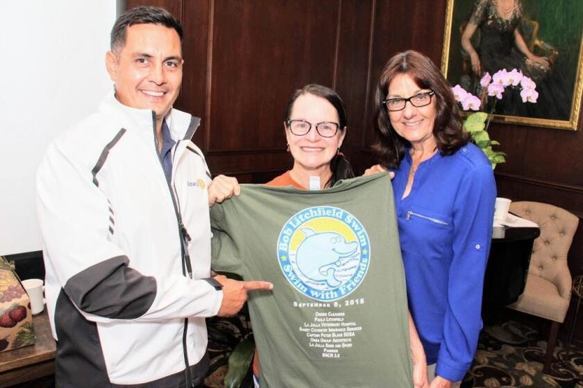 La Jolla Sunrise Rotary President Kilma Lattin with Paula Litchfield and San Pasqual Academy's Debby Syverson after this year's Robert Litchfield Memorial Swim