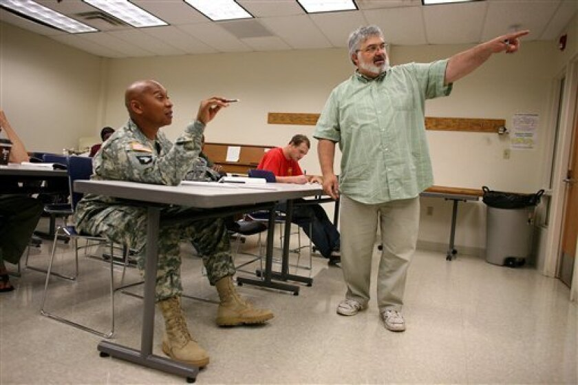 In a Thursday June 4, 2009 photo, Sergeant 1st class Brendon Daniels, left, talks with Music Appreciation teacher Richard Steffen at the SSG Glenn H. English Jr., Army Education Center of Austin Peay University at the Fort Campbell Army Base in Fort Campbell, Ky. (AP Photo/Josh Anderson)