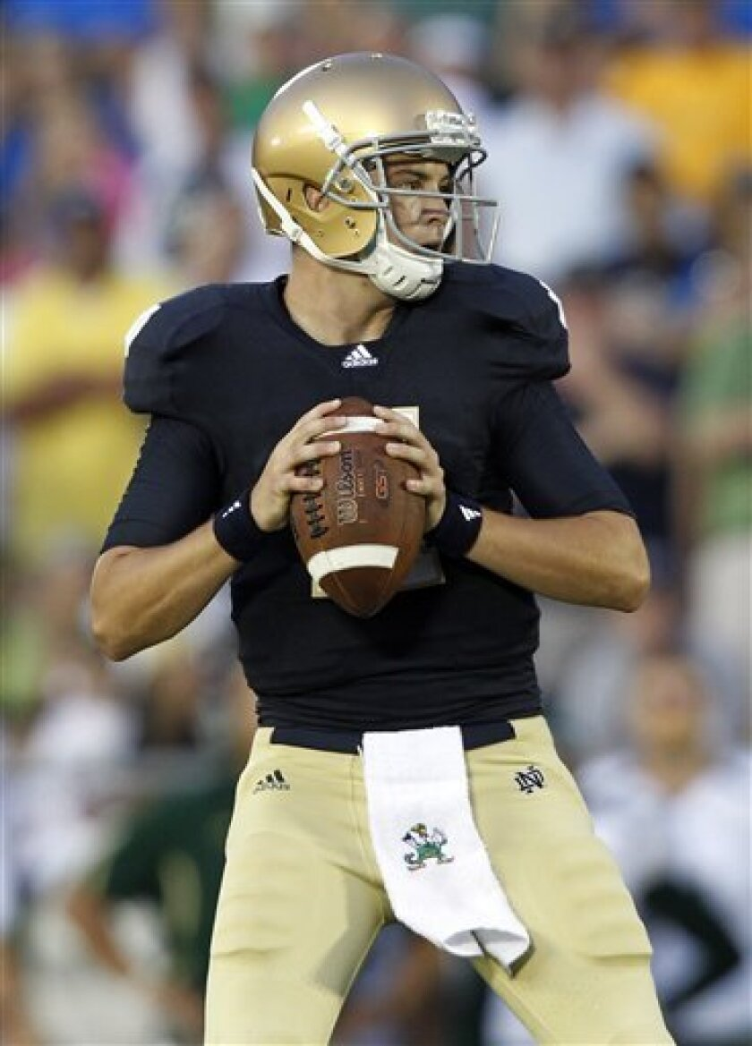 Notre Dame quarterback Tommy Rees drops back to throw against South Florida in the third quarter of an NCAA college football game in South Bend, Ind., Saturday, Sept. 3, 2011. (AP Photo/Michael Conroy)