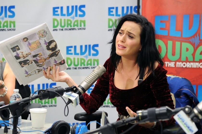 """Katy Perry, shown during a visit to a New York radio station, has a hit with her song """"Roar,"""" but fans have noticed similarities between her new single and Sara Bareilles' song """"Brave."""""""