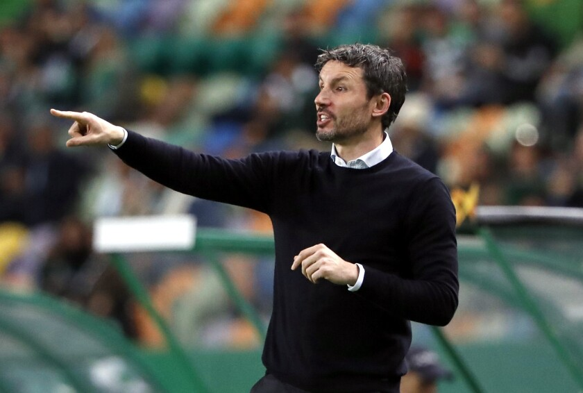 FILE - In this Thursday, Nov. 28, 2019 file photo then head coach of PSV Eindhoven, Mark van Bommel, gives instructions from the side line during the Europa League group D soccer match between Sporting CP and PSV Eindhoven at the Alvalade stadium in Lisbon, Portugal. (AP Photo/Armando Franca)