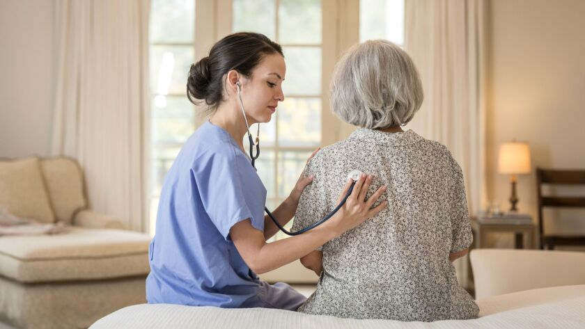 A woman receives hospital-level care from a nurse in her home. More Americans are opting to spend their final days at home instead of in a hospital, according to a new study.