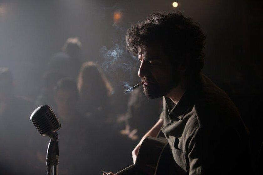 """Still from the movie """"Inside Llewyn Davis."""" Llewyn (Oscar Isaac) performs at the Gaslight."""