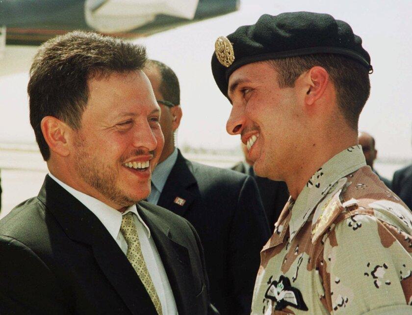 Jordan's King Abdullah II with his half brother Prince Hamzah in 2001