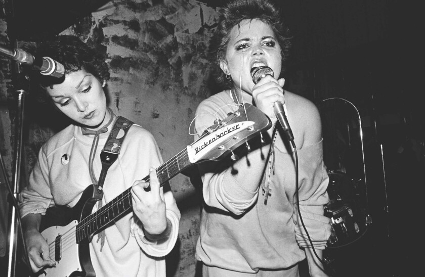 Jane Wiedlin and Belinda Carlisle of the Go-Go's are shown performing an early club gig.