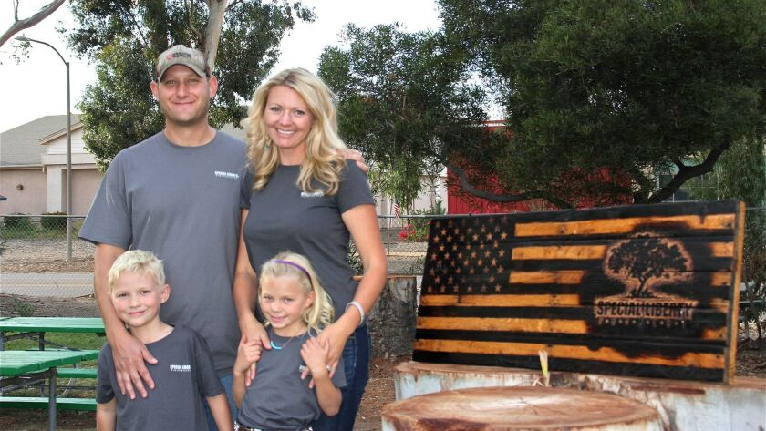 U.S. Navy Chief Petty Officer Cory Merritt, his wife, Jessica, and their 6-year-old twins, Wesley and Charlotte