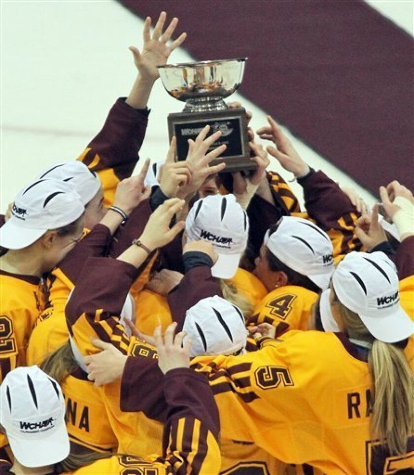 In this March 9, 2013 photo, the Minnesota women's hockey team celebrates after winning the WCHA championship game, 2-0, against North Dakota in Minneapolis. Not only has the Minnesota women's hockey team not lost in 46 consecutive games, the Gophers haven't even given up a goal in a month. (AP Pho