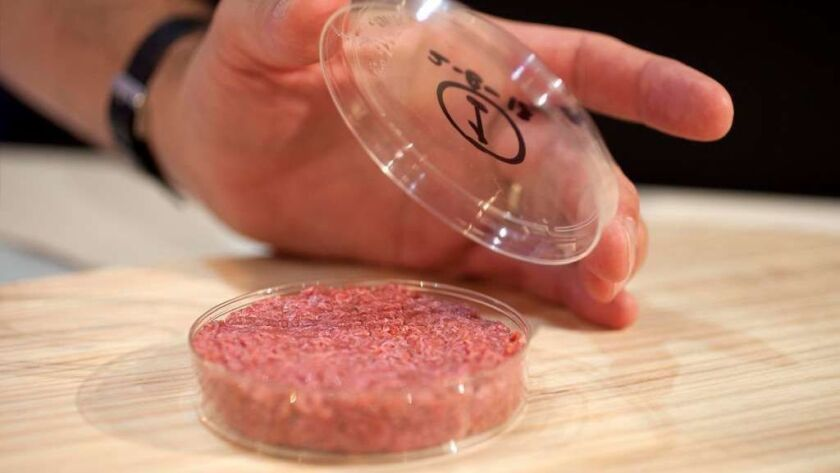 The world's first lab-grown beef burger is unveiled in London on Aug. 5, 2013. On March 7, 2019, U.S. regulators formalized an agreement on how meat from cultured animal cells will be regulated.