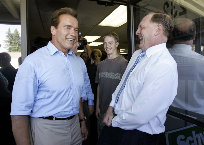 Duf Sundheim, right, smiles with Arnold Schwarzenegger, then California governor, at the July 2006 opening of an office for Schwarzenegger's reelection campaign in Mountain View, Calif.
