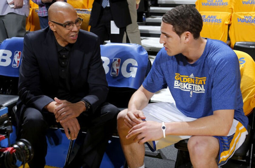 Warriors guard Klay Thompson talks to his father and broadcaster Mychal Thomposon before Game 3 of the playoff series against the Spurs in Oakland.