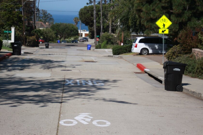 Improvements to the Fay Avenue Bike Path extension at La Cañada include stenciling on the street, new signage and new red paint on the curb.