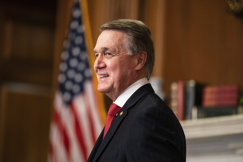 Sen. David Perdue, R-Ga., meets with Judge Amy Coney Barrett, President Donald Trumps nominee for the U.S. Supreme Court, not pictured, on Capitol Hill in Washington, Wednesday, Sept. 30, 2020. (Anna Moneymaker/The New York Times via AP, Pool)