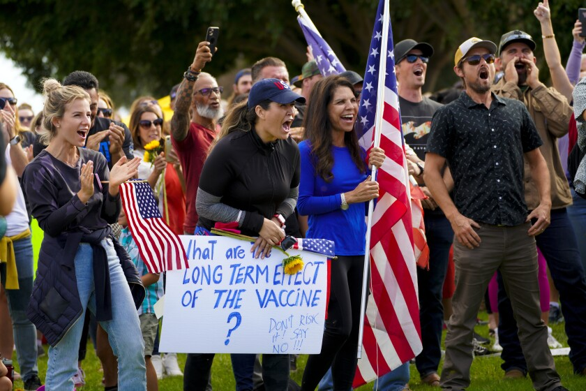 A crowd protests a vaccine mandate proposal at the San Diego Unified School District headquarters Sept. 28.